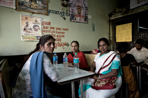 Hajra, Mumtaz, and Sheinaz take a break from fieldwork in a red-light district in Solapur, South Maharashtra. The three women work as peer educators with SAI, an NGO based in Mumbai. Photo by Helen Rimell, in Vice magazine.