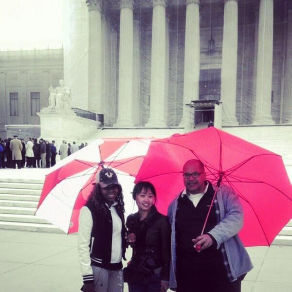 Red umbrellas in solidarity against the anti-prostitution loyalty oath this Monday (photo courtesy of Desiree Alliance--our very own contributor Kate Zen is in the middle)