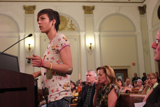 Magalie speaking at a city council meeting. (Photo by Kendra Kellog)