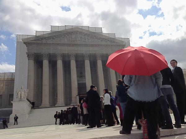 A lone red umbrella at the Supreme Court for the hearings on the anti prostitution loyalty pledge. (photo courtesy of  Chi Mgbako and the Leitner Center?)