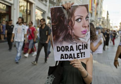 A protest held vs. transphobic and homophobic violence in Kusadasi, Turkey, this Friday,  in memory of Dora Oezer, a 24 year old trans sex worker murdered earlier last week. (Photo by AP Photo/Vadim Ghirda)