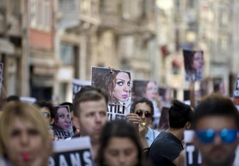 "Turkish LGBT groups protest Dora Oezer's murder in Istanbul. Her face stares out of multiple signs that demand, ""Justice for Dora!"" (Photo by AP Photo/Vadim Ghirda/Scanpix)"
