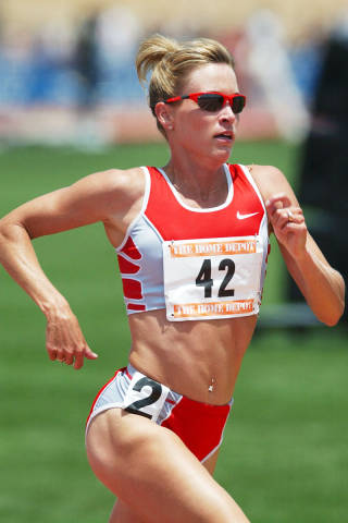 Suzy Favor Hamilton in all her badass athletic glory (photo by Getty Images)
