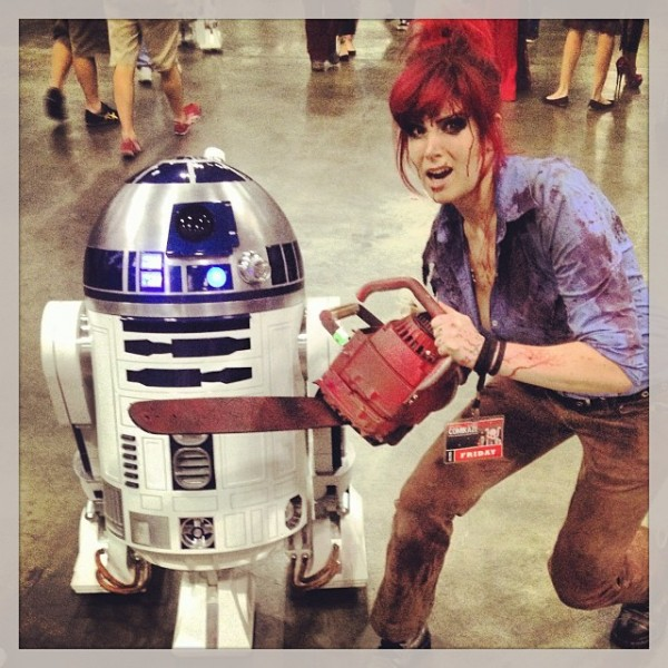 Gimmie some sugar, baby. Josie, as Evil Dead's Ash, hanging with R2D2.