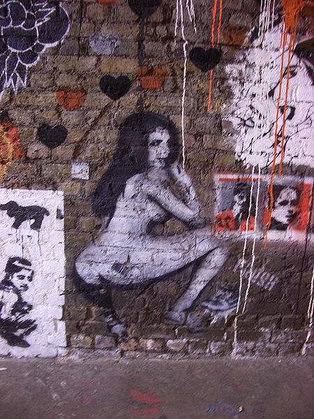 We don't know what this is but we suspect Ruth Fowler would be into it, given that it involves a naked woman and fecal implications. (Photo of stripper graffiti via Wikipedia Commons)