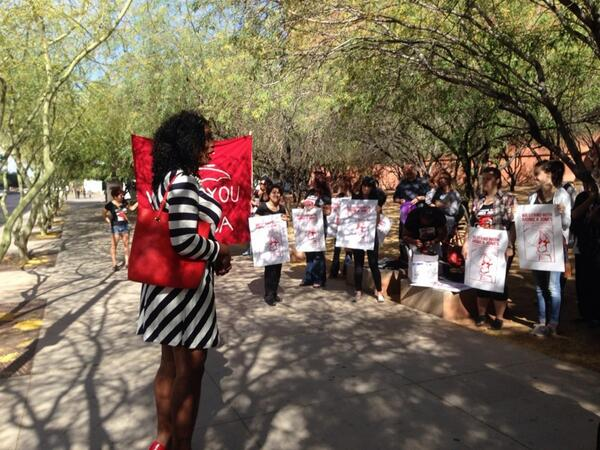 """Monica Jones addresses a crowd of her supporters before her court date today: """"Because you walk a certain way, because you look a certain way they can arrest you for manifestation...We will not tolerate the profiling of trans women of color."""" (Photo via SWOP-Phoenix's twitter account)"""