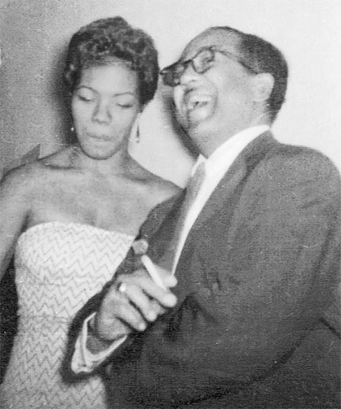 A young, beautiful Maya Angelou with Langston Hughes, not long after her career as a sex worker—guess she didn't think his joke was that funny? (Photo via mayaangelou.com)