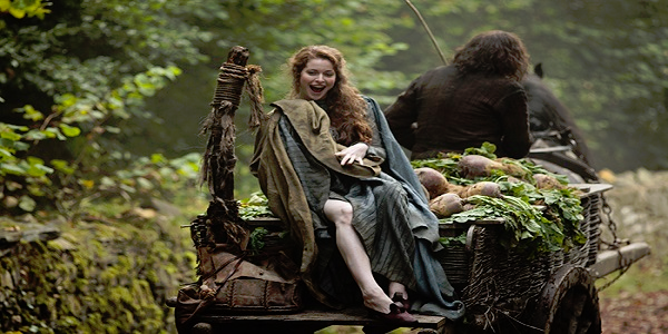Ros (Esme Bianco) on the wagon ride that will take her from a brothel in the North to a much more well to do establishment in King's Landing (screenshot from  Game of Thrones)