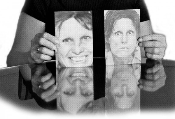 Cris Sardina of Desiree Alliance holds up pictures of Marcia Powell (Photo by P.J. Starr via the NO HUMAN INVOLVED Facebook page)