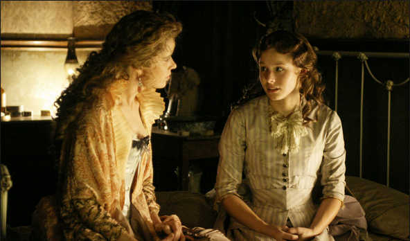 Flora seducing Joanie. (Still from Deadwood)