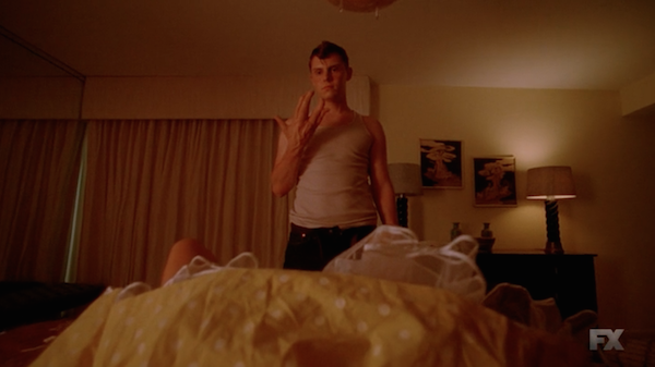 Jimmy at work at that Tupperware party. You gotta love that client's skirt. (Screenshot from American Horror Story)