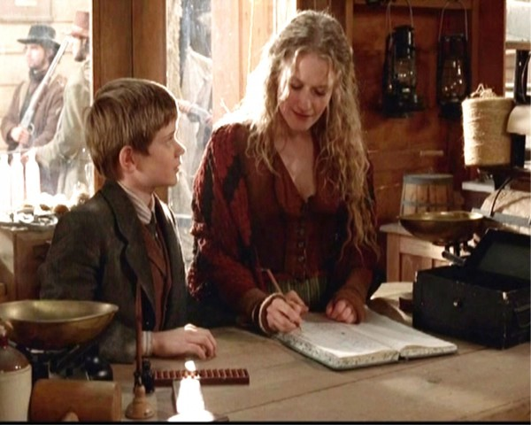 Trixie doing her book keeping. (Still from Deadwood)