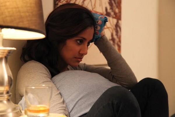 Manini Gupta as Al nursing a phone sex related headache in Small Talk. (Still from Small Talk, courtesy of Nicole Witte Solomon)