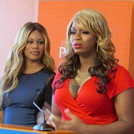 Jones speaking as Laverne Cox looks on. (Photo via Jones' Facebook, courtesy of Monica Jones)