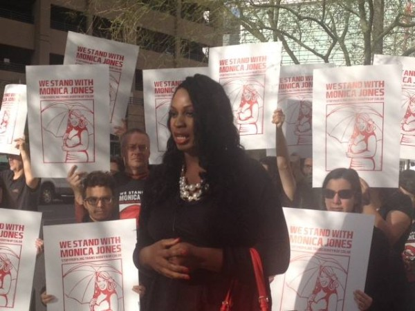 Jones speaking before her pre-trial this March, flanked by supporters. ( Photo via Support Monica Jones' Facebook, courtesy of Monica Jones)