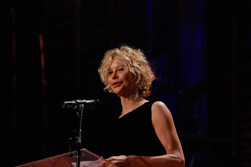 Meg Ryan doing a TED talk in 2010. (Photo by Flickr user redmaxwell)