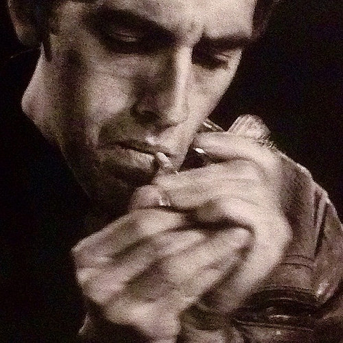 """David Wojnarowicz, critically acclaimed artist, ACT UP activist,  and street sex worker. (A detail from a Peter Hujar portrait of David Wojnarowicz, """"David Lighting Up,"""" 1985, photo by Flickr user mbschlemmer)"""