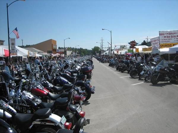 Bikes lined up on Main Street during the Sturgis Motocross Rally in South Dakota. (Photo by Cumulus Clouds via wikimedia)