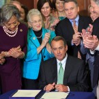 These people look very pleased with themselves. (Photo of Speaker of the House Joe Boehmer signing the Justice for Victims of Trafficking Act, via Boehmer's Flickr account)