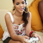 Rihanna playing X-Box. (Photo by Gamer Score Blog, via Flickr)