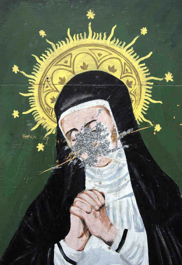 A Virgin Mary mural in Madrid. Photo taken by Perivolaris. (image via Flickr user drjohn2005)